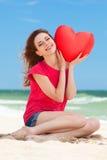 Muchacha con forma del corazón Imágenes de archivo libres de regalías