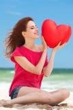 Muchacha con forma del corazón Imagen de archivo