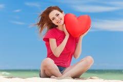 Muchacha con forma del corazón Imagenes de archivo