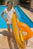 Muchacha con inflable por la piscina Imágenes de archivo libres de regalías