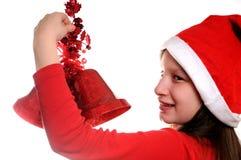 Muchacha con la alarma de la Navidad Fotos de archivo