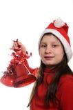 Muchacha con la alarma de la Navidad Fotografía de archivo libre de regalías