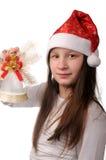 Muchacha con la alarma de la Navidad Foto de archivo