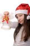 Muchacha con la alarma de la Navidad Imagen de archivo libre de regalías