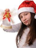 Muchacha con la alarma de la Navidad Foto de archivo libre de regalías