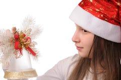 Muchacha con la alarma de la Navidad Imagen de archivo