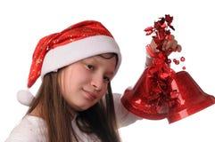 Muchacha con la alarma de la Navidad Fotografía de archivo