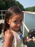 Muchacha con la barra de pesca Imagen de archivo libre de regalías