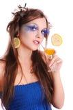 Muchacha con la bebida anaranjada Imagen de archivo libre de regalías