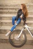 Muchacha con la bici Imágenes de archivo libres de regalías
