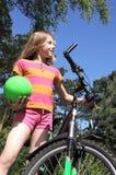 Muchacha con la bicicleta Foto de archivo