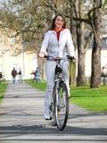 Muchacha con la bicicleta Imágenes de archivo libres de regalías