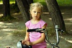 Muchacha con la bicicleta Imagen de archivo libre de regalías