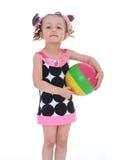 Muchacha con la bola coloreada Fotos de archivo