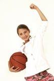 Muchacha con la bola de la cesta Fotos de archivo
