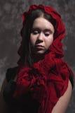 Muchacha con la bufanda roja Foto de archivo libre de regalías