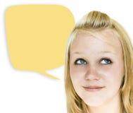 Muchacha con la burbuja amarilla del discurso Foto de archivo libre de regalías