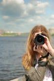 Muchacha con la cámara Imagen de archivo
