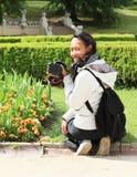 Muchacha con la cámara Foto de archivo