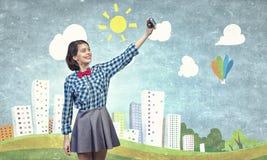 Muchacha con la cámara de la foto Imagen de archivo