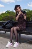 Muchacha con la cámara digital Foto de archivo libre de regalías