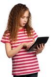 Muchacha con la calculadora Imágenes de archivo libres de regalías