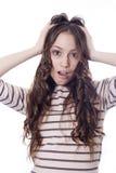 Muchacha con la cara de la expresión Foto de archivo libre de regalías