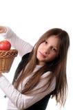 Muchacha con la cesta de manzanas Fotos de archivo libres de regalías