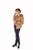 Muchacha con la chaqueta marrón. Fotos de archivo