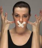 muchacha con la cinta en los labios Imágenes de archivo libres de regalías