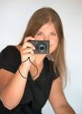 Muchacha con la cámara digital Foto de archivo