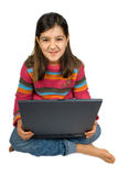 Muchacha con la computadora portátil Foto de archivo