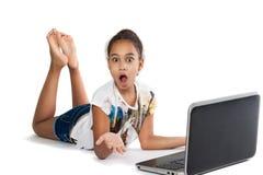 Muchacha con la computadora portátil Foto de archivo libre de regalías