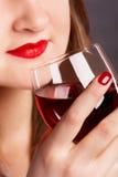 Muchacha con la copa de vino Imagenes de archivo