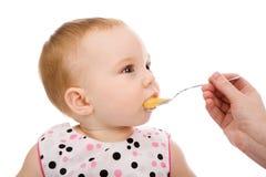 Muchacha con la cuchara Fotos de archivo