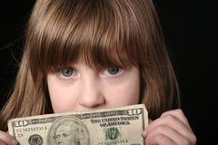 Muchacha con la cuenta de dólar diez fotografía de archivo