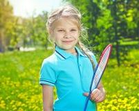 Muchacha con la estafa de tenis Imagen de archivo