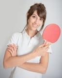 Muchacha con la estafa de tenis de mesa Foto de archivo libre de regalías