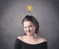 Muchacha con la expresión facial divertida Imagen de archivo libre de regalías