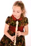 Muchacha con la flauta Imágenes de archivo libres de regalías