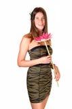 Muchacha con la flor. Fotografía de archivo