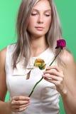 Muchacha con la flor Imagen de archivo libre de regalías