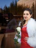 Muchacha con la flor Foto de archivo