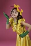 Muchacha con la flor en su cabeza Imagen de archivo libre de regalías