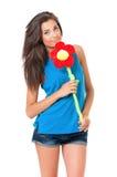 Muchacha con la flor grande Foto de archivo