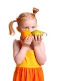 Muchacha con la fruta Foto de archivo libre de regalías