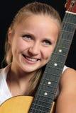 Muchacha con la guitarra Fotos de archivo libres de regalías