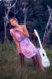 Muchacha con la guitarra Fotografía de archivo libre de regalías