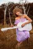Muchacha con la guitarra Foto de archivo