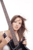 Muchacha con la guitarra baja Fotografía de archivo libre de regalías